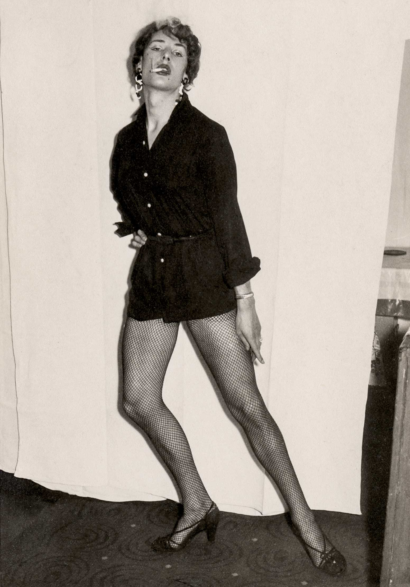 Man dressed as a woman, Mannheim, Germany, circa 1960.