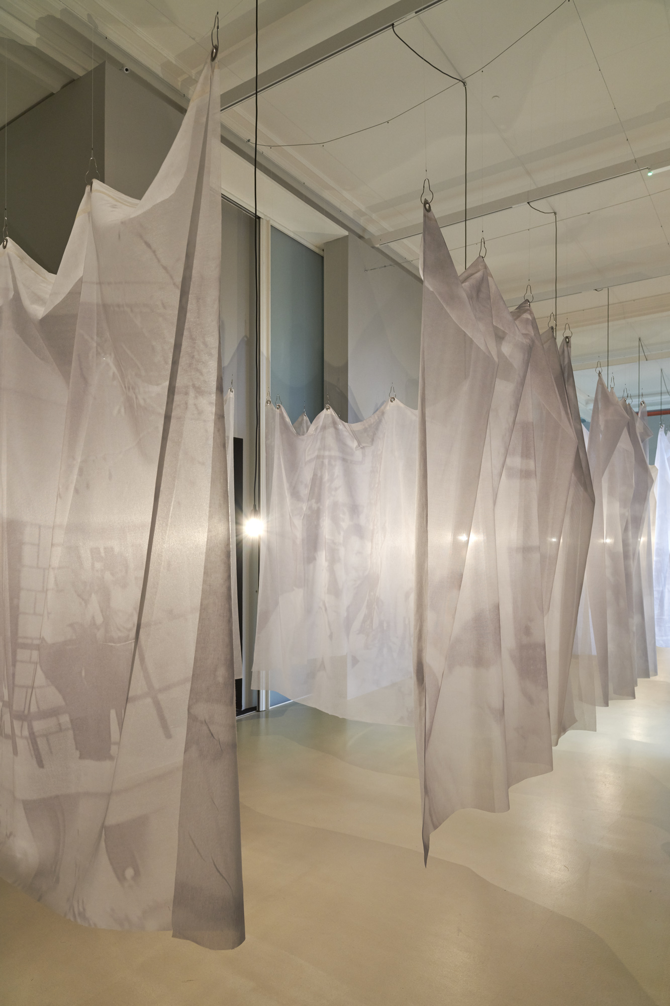 La traversée de la vie (The Crossing of Life), 2015 31 printed veils, 12 light bulbs, wire, electric wire