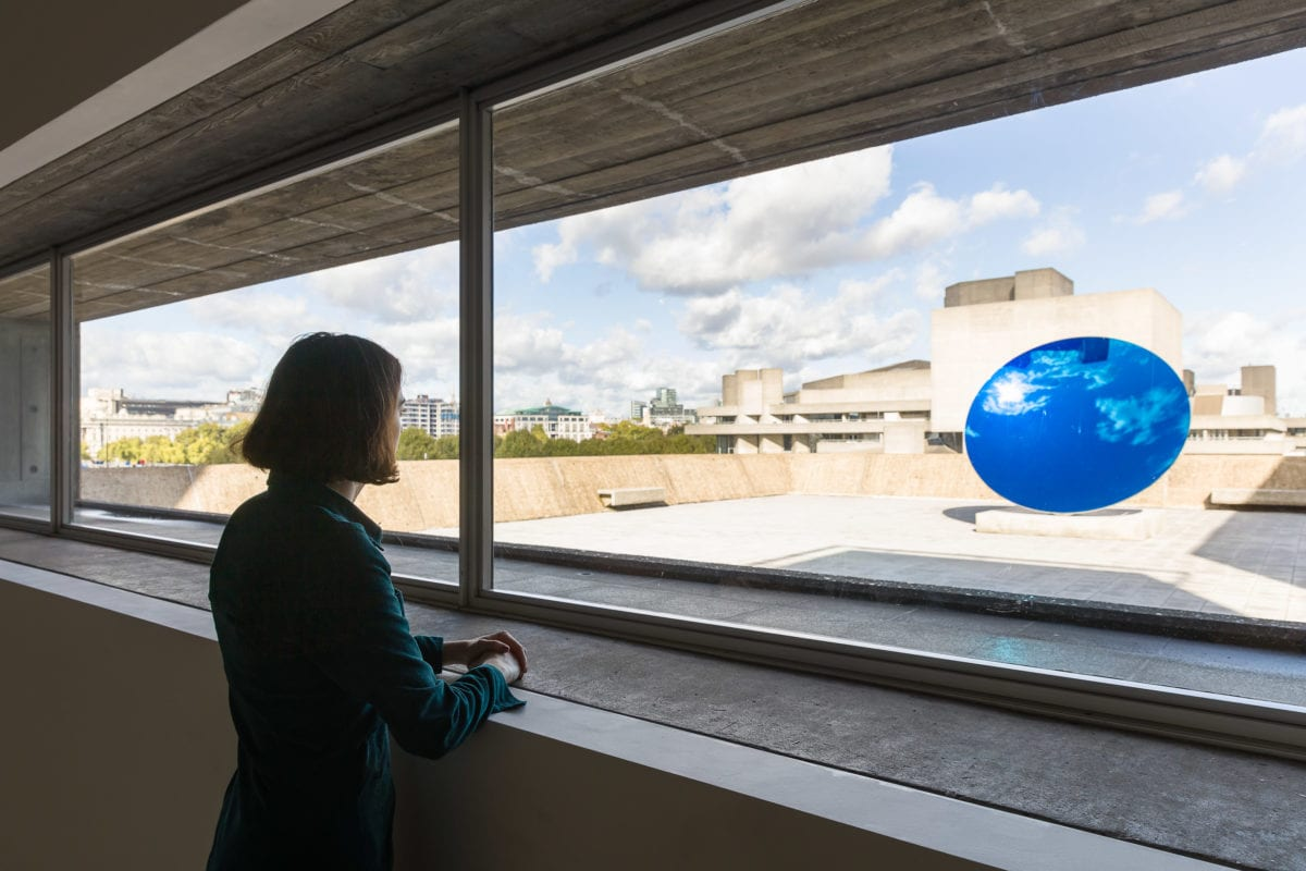 Installation view of Anish Kapoor, Sky Mirror Blue, 2016, at Space Shifters © copyright the artist, courtesy Hayward Gallery 2018. Photo by Mark Blower.