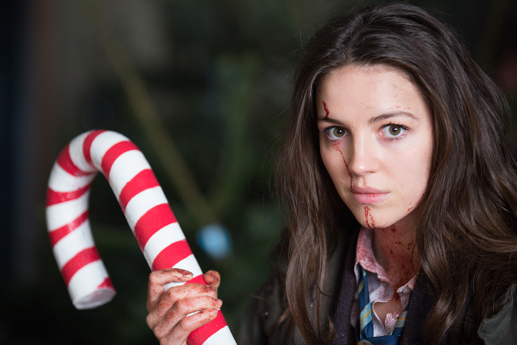 Ella Hunt (Anna) in the Christmas Tree Emporium with her candy cane as a weapon