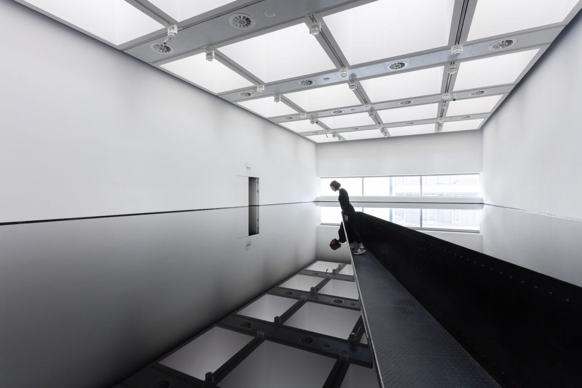Installation view of Richard Wilson, 20:50, 1987 at Space Shifters. Courtesy of Hayward Gallery 2018. Photography by Mark Blower