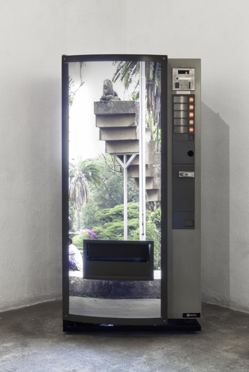 Invernomuto, Still da Video, 2014. Drink dispenser, digital print on plexiglass