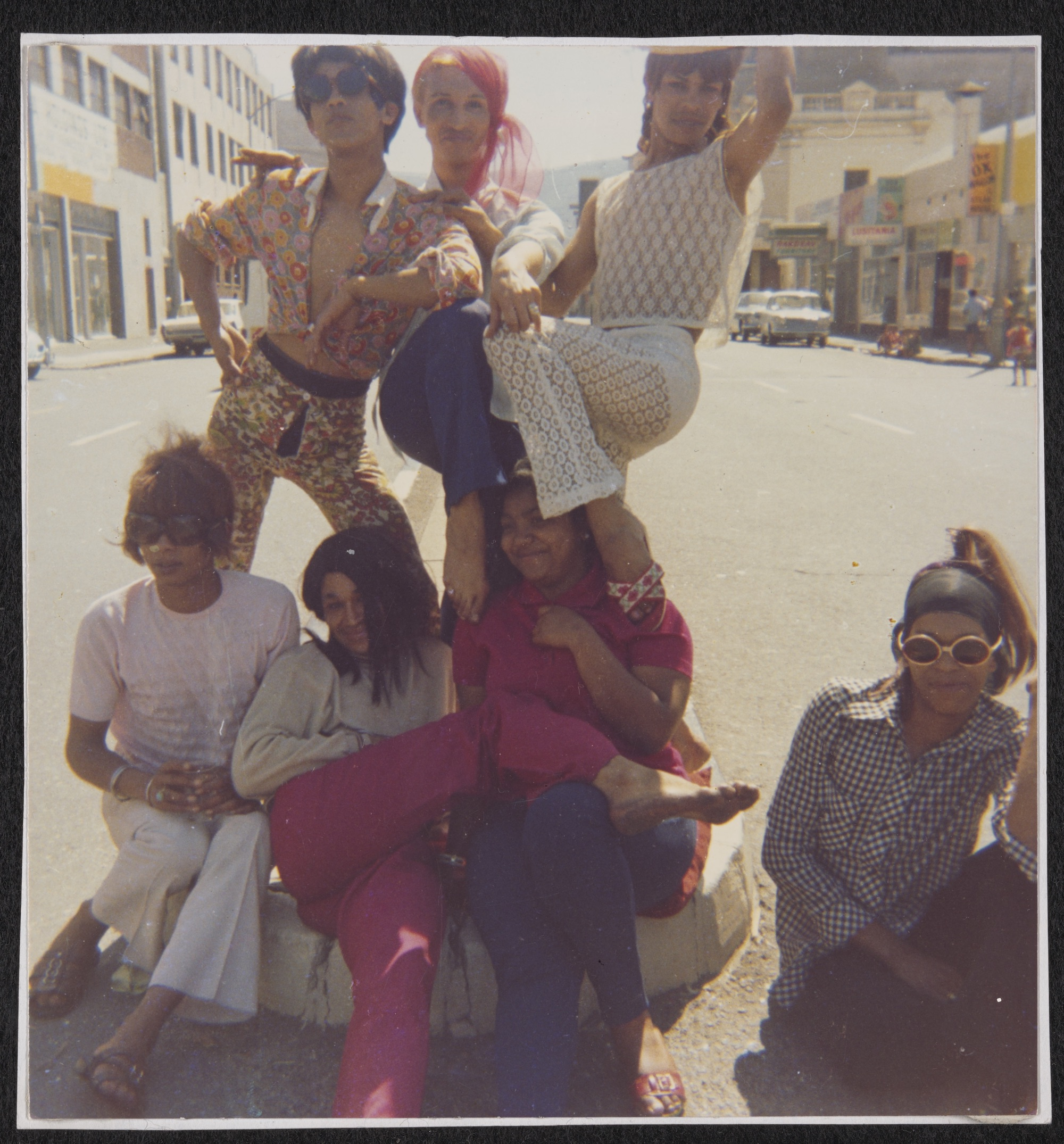 Olivia, Kewpie, Patti, Sue Thompson, Brigitte, Gaya, and Mitzy in the Middle of the Street: Group Picture on Sir Lowry Road, circa 1960 to circa 1980