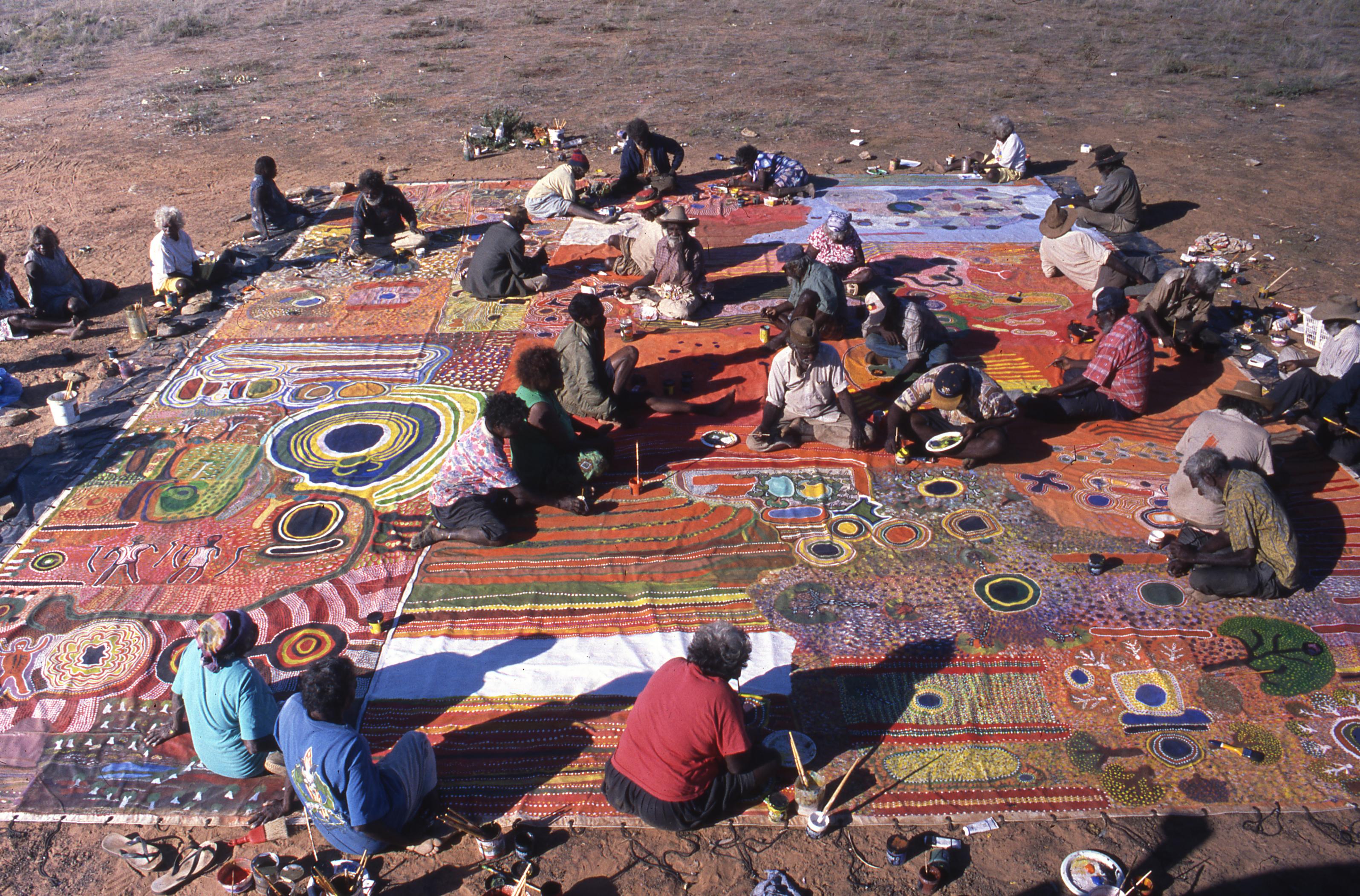 Ngurrara artists producing Ngurrara Canvas II at Pirnini, May 1997. Photo by K. Dayman (Ngurrara Artists and Mangkaja Arts Resource Agency)