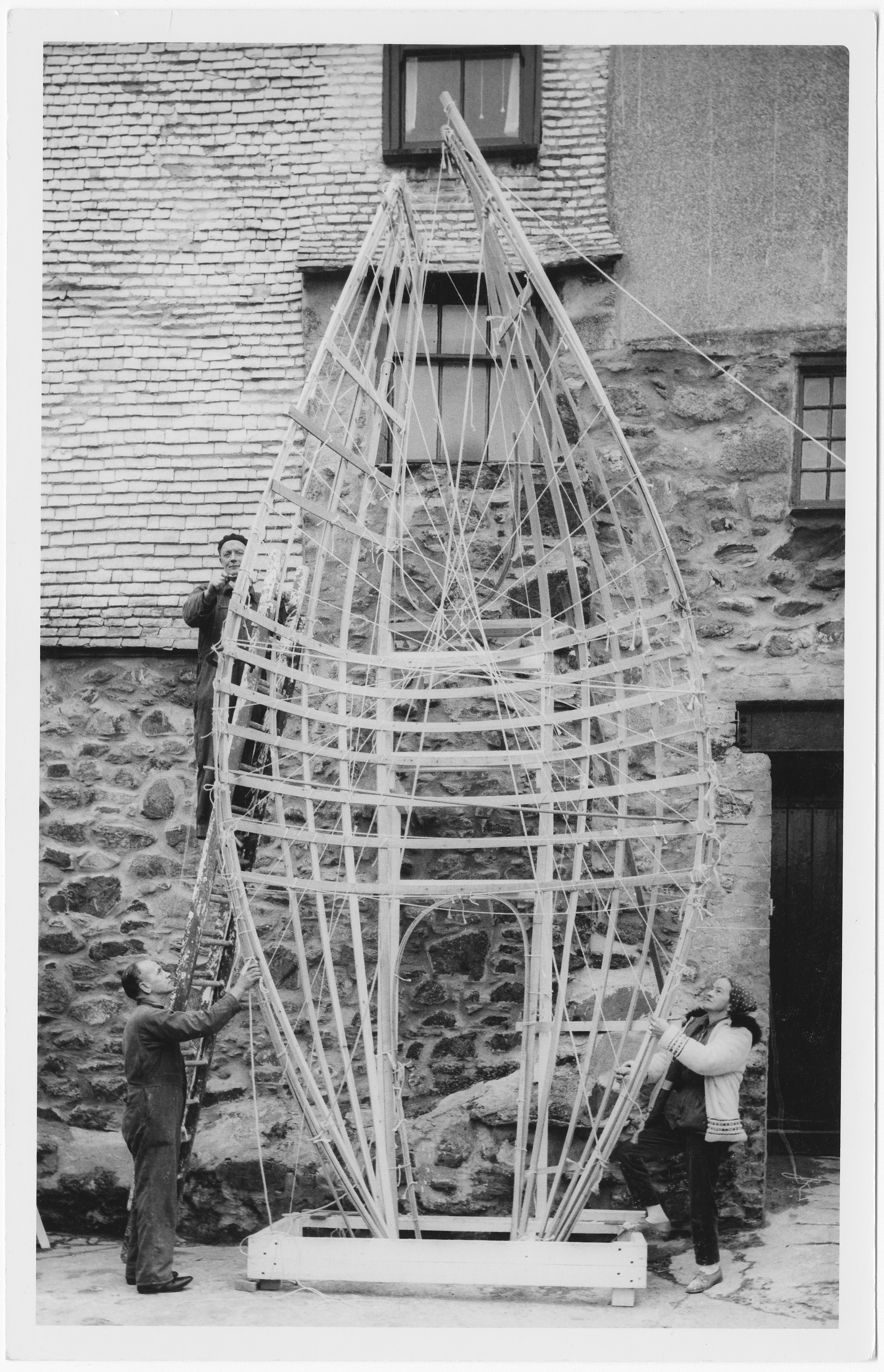 Barbara Hepworth working on the first stage of the armature of the Winged Figure prototype, 31 January 1962