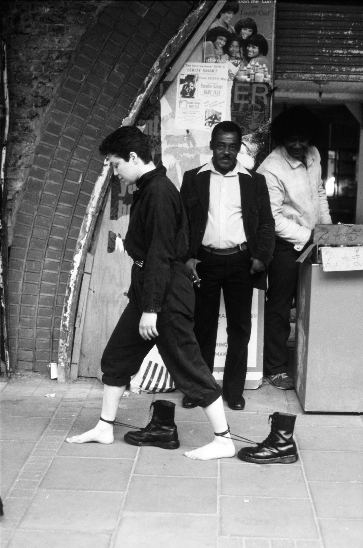 Mona Hatoum, Roadworks, 1985, Live action with Dr Martens boots, Performed in Brixton, London © Mona Hatoum. Courtesy Brixton Art Gallery (Photo: Patrick Gilbert)