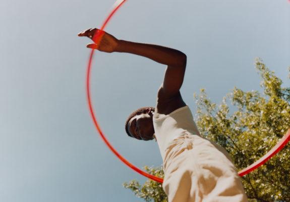 Tyler Mitchell, Untitled (Sosa with Orange Hula Hoop), 2019