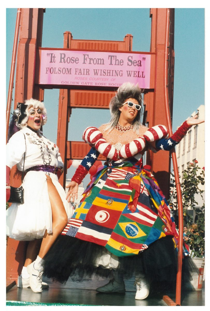 Gilbert Baker (right), wearing his international flags gown, stands with Sister Sadie, Sadie the Rabbi Lady (left) on a Golden Gate Bridge–themed float (ca. 1987); photograph by Robert Pruzan, collection of the GLBT Historical Society