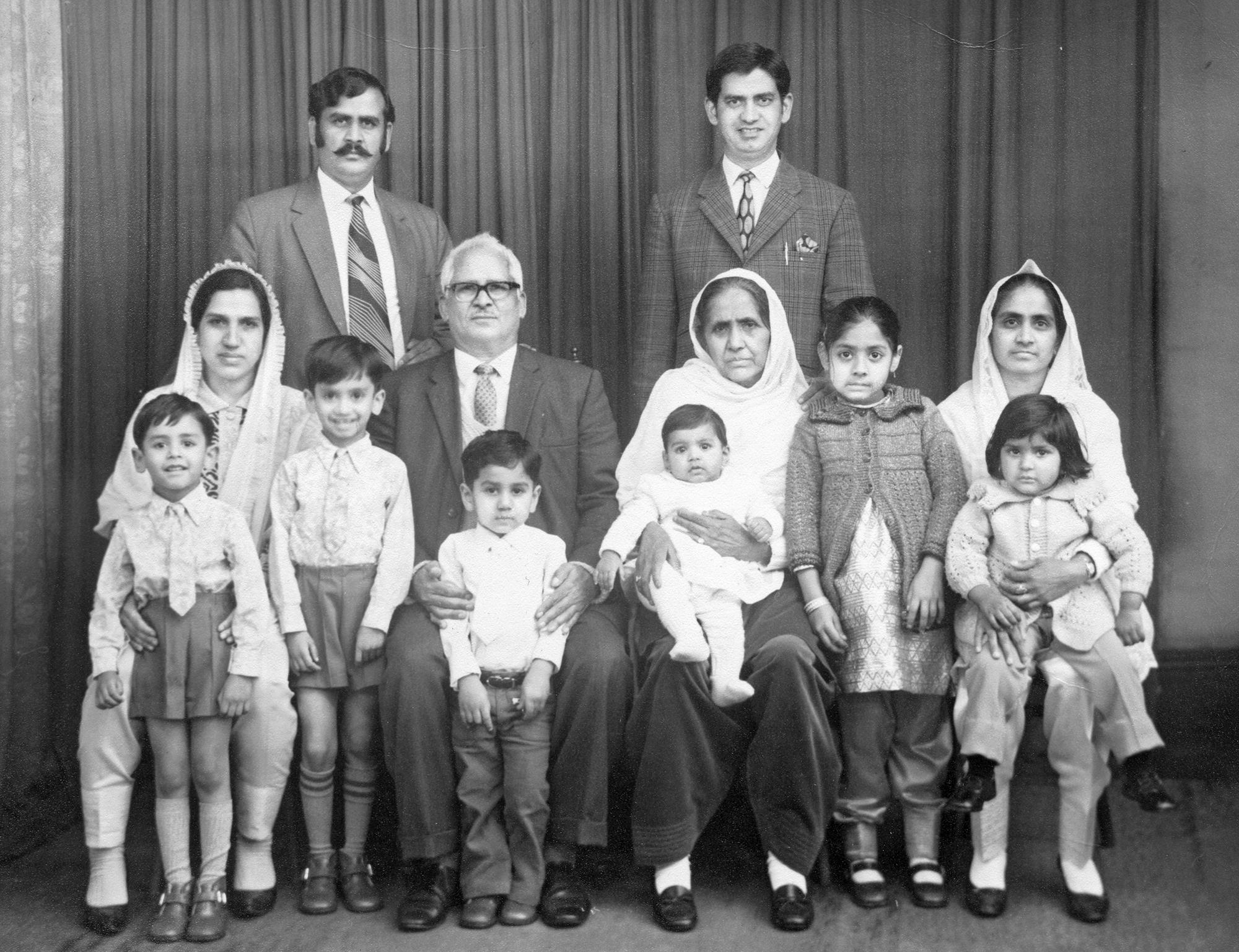 Belle Vue Studios portrait of a 3 generation South Asian family