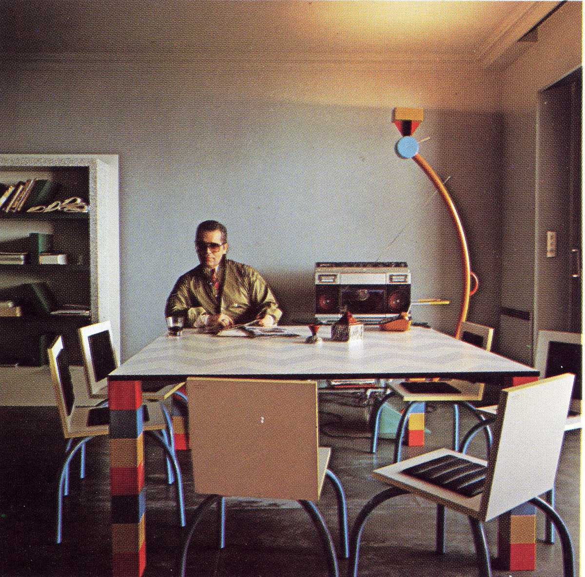 "Karl Lagerfeld in his Monte Carlo apartment. ""Pierre"" table by Sowden, ""Riviera"" chair by De Lucchi, ""Treetops"" lamp and ""Suvretta"