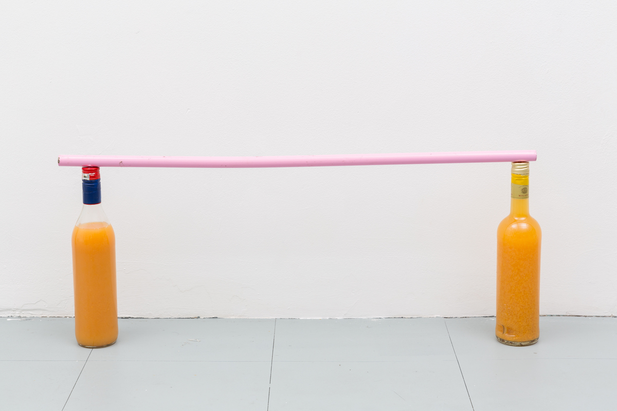 Guillaume Vandame, Gloria, 2019, found bottles with mysterious orange liquid, found pink metal pole