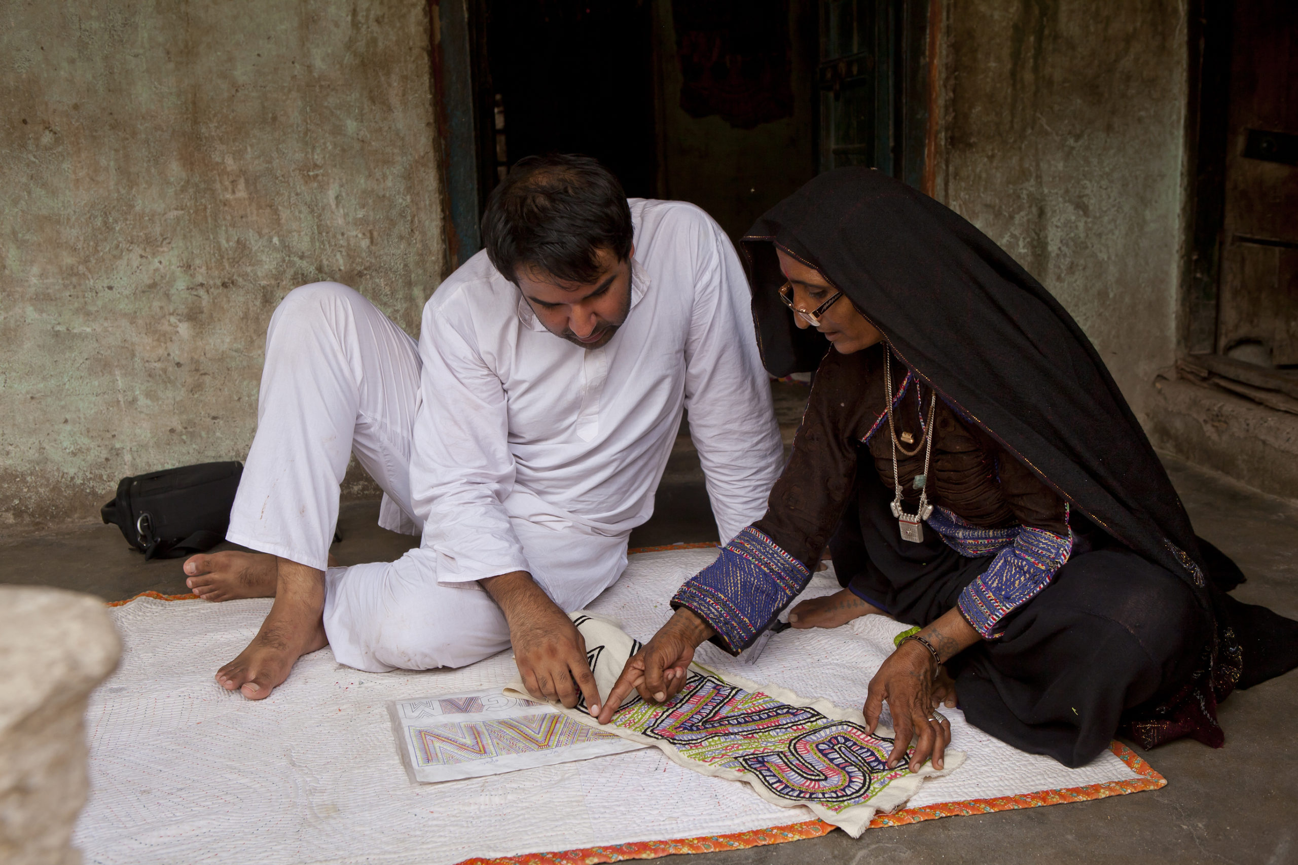 A discussion between Ishan and Sajnu ben, a craftswoman form the Dhebaria Rabari community, at her home in Kukadsar village in Kutch, Gujarat