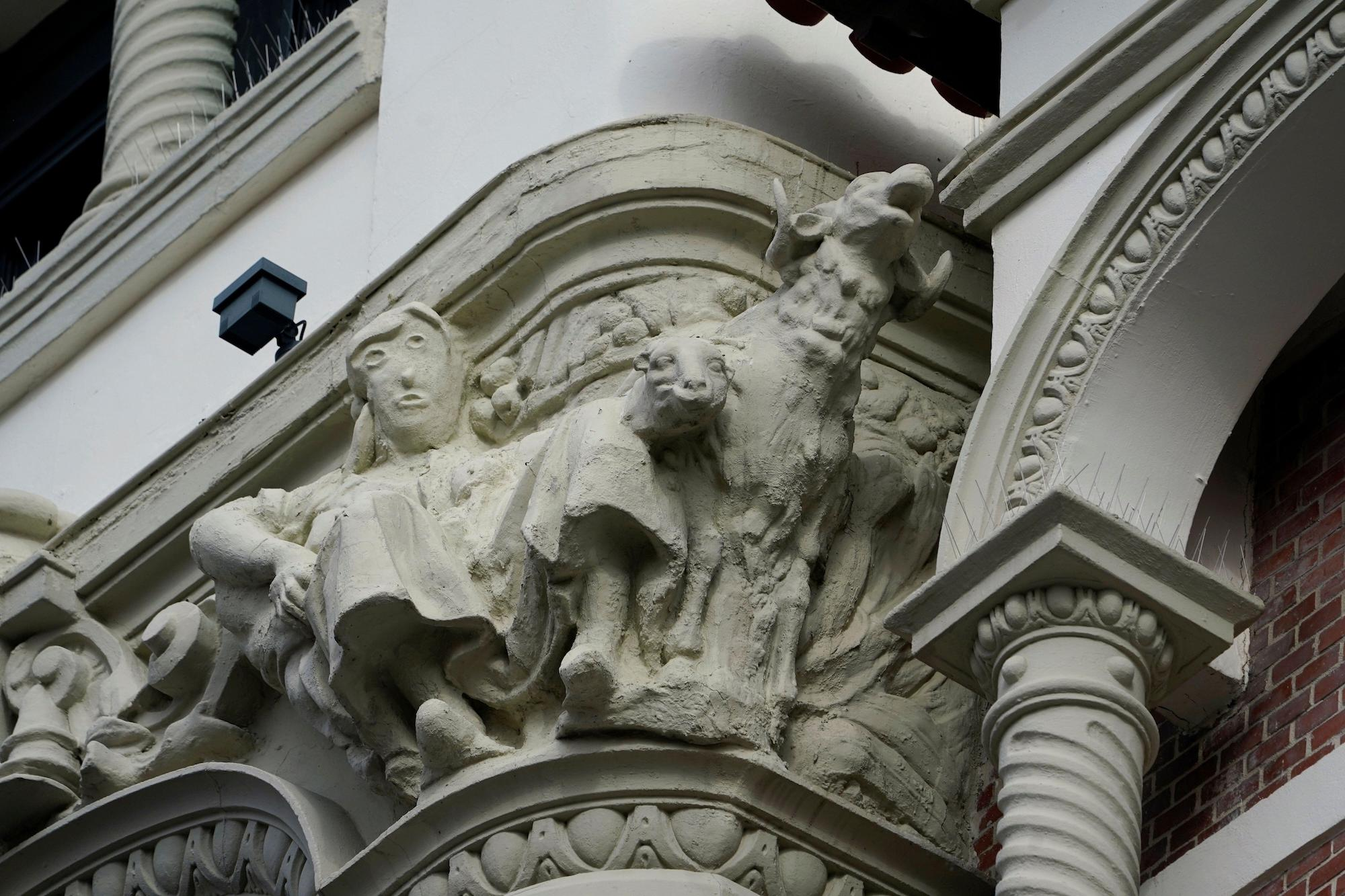 The botched restoration of a shepherdess figure in seen on a building, amid the coronavirus disease (COVID-19) outbreak, in Palencia, Spain November 14, 2020. REUTERS/Vincent West