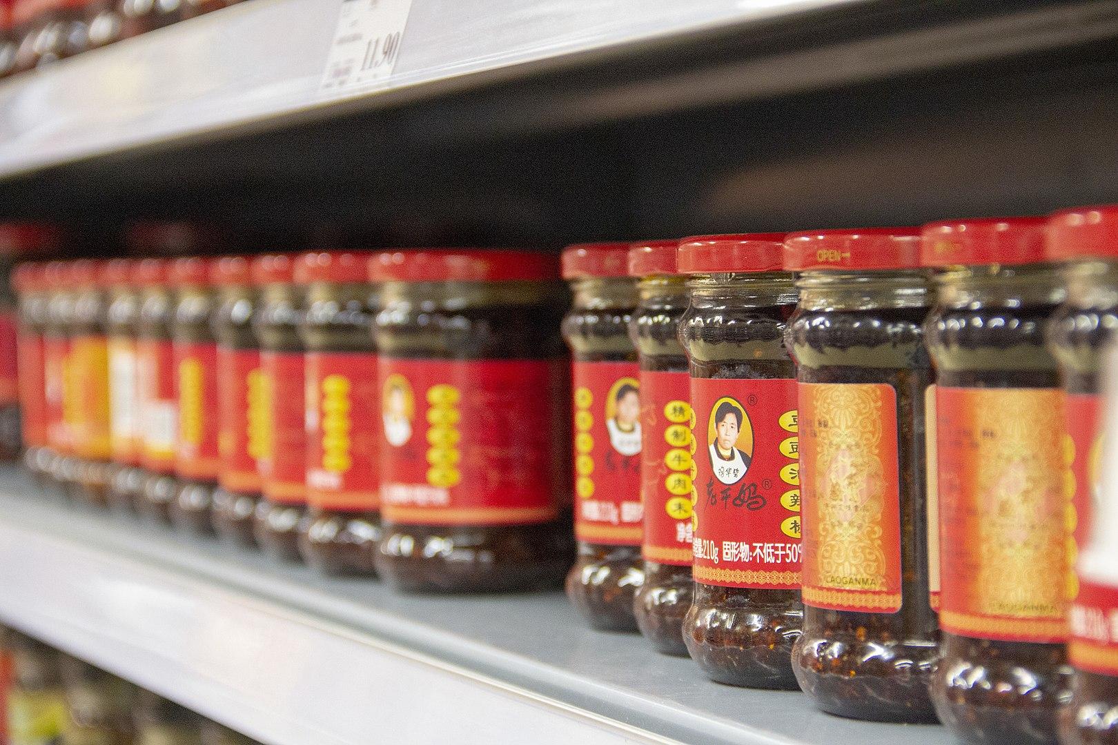 Lao Gan Ma jars on shelves via Wikimedia Commons