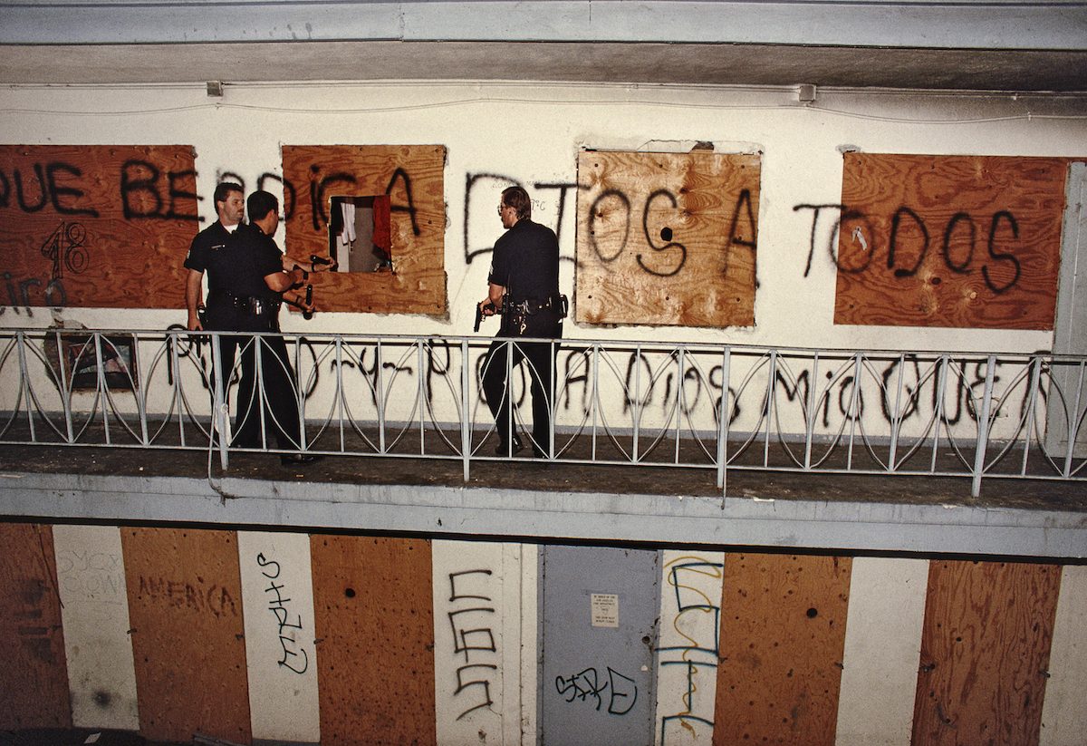 Rampart officers search an abandoned motel for a murder suspect. The building is just a few blocks from Charlie Chaplin's old mansion. © Joseph Rodriguez, from LAPD 1994