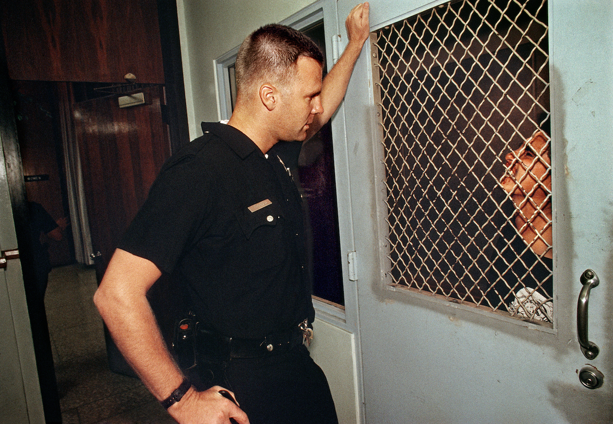 Rampart Division officers detaining an arrested woman.© Joseph Rodriguez, from LAPD 1994