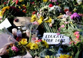 College Green, Bristol, UK. 16th Mar 2021. Floral tributes laid during the reclaim the Streets vigil for Sarah Everard. Courtesy JMF News/Alamy Live News