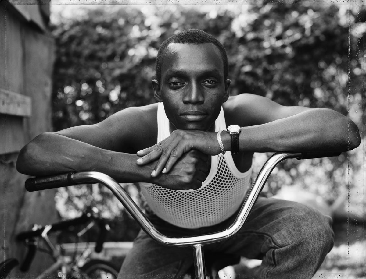 A Young Man Resting on an Exercise  Bike, Amityville, NY, 1988. Courtesy the artist and MACK