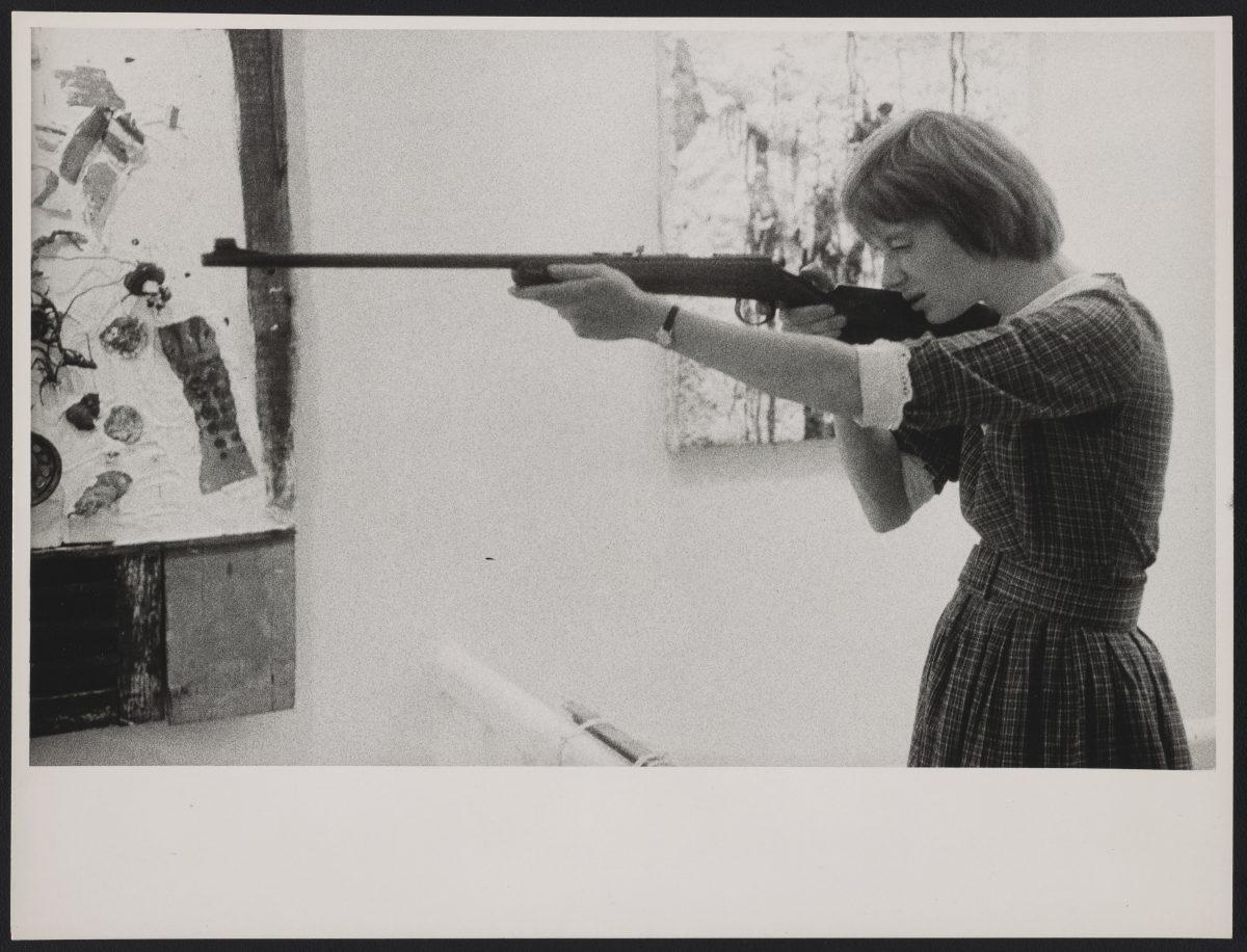 """Niki de Saint Phalle shooting and exhibition opening, """"Feu a Volonté,"""" Galerie J, Paris, 1961. Photo: Shunk-Kender © J Paul Getty Trust"""